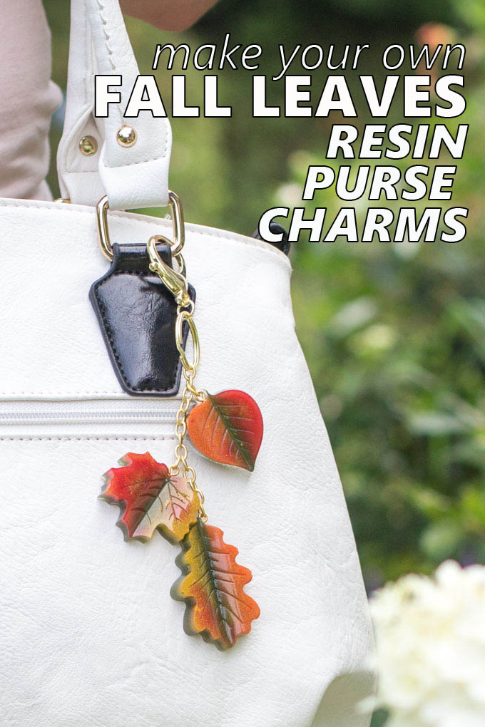 Red, yellow and orange DIY fall leaves resin charms hanging on a purse