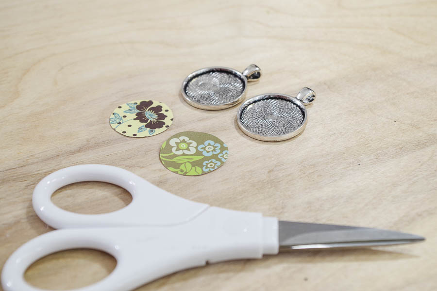 DIY paper and resin pendants - cut paper into circles to fit in bezels