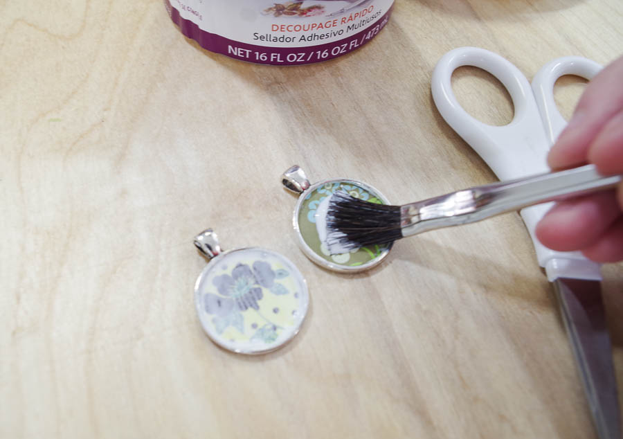 DIY paper and resin pendants - glue paper into bezels by coating over paper
