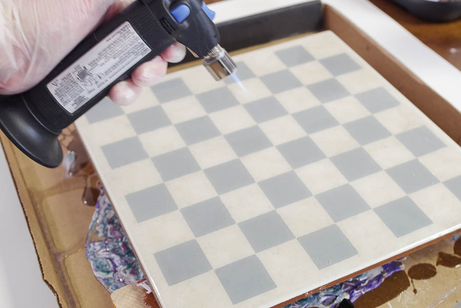 Upcycle Tile to Resin Coated Chess Board - pop bubbles with micro butane torch
