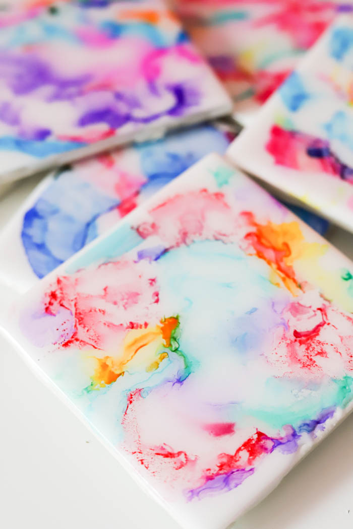Create colorful coasters with markers, isoprophyl alcohol, and a lighter then coat with EnviroTex Lite® Pour On High Gloss Finish. #resin #resincrafts #giftideas