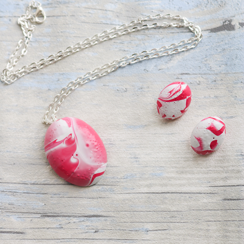 Make an Easter egg necklace and earrings with this simple DIY tutorial and fast cast resin. Includes instructions for adding marbling paint to your craft project! #marbled #easter #spring
