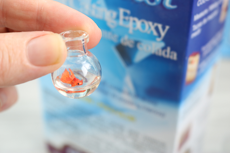 adding a fish to a necklace