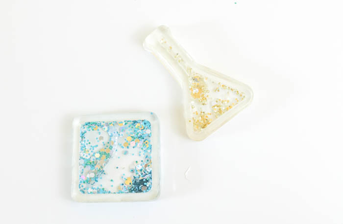 fillable resin charms on a white background