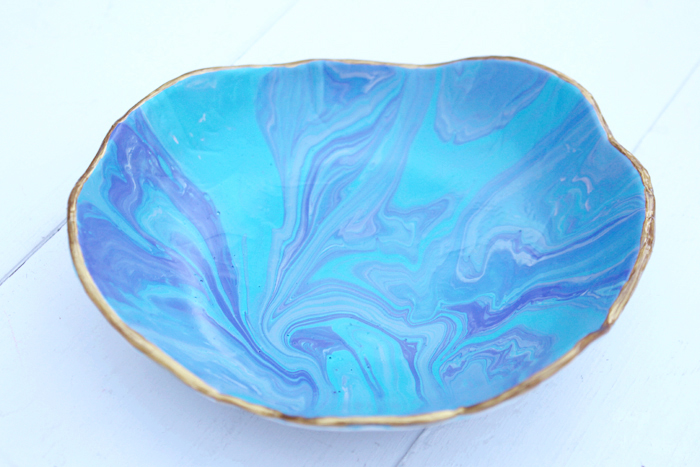 Make a marbled ring dish with Easy Sculpt resin trimmed in gold for a gift or the perfect ring storage solution.