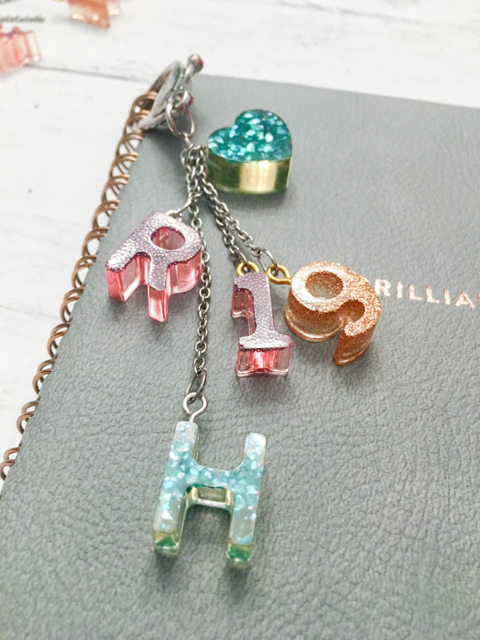 Close up image of a keychain made with resin monograms.