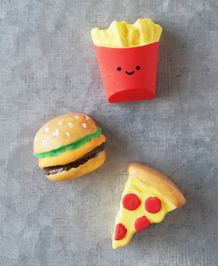 Painted resin junk food magnets on metal board