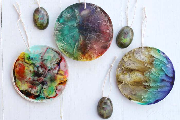 Make resin alcohol ink Christmas tree ornaments.