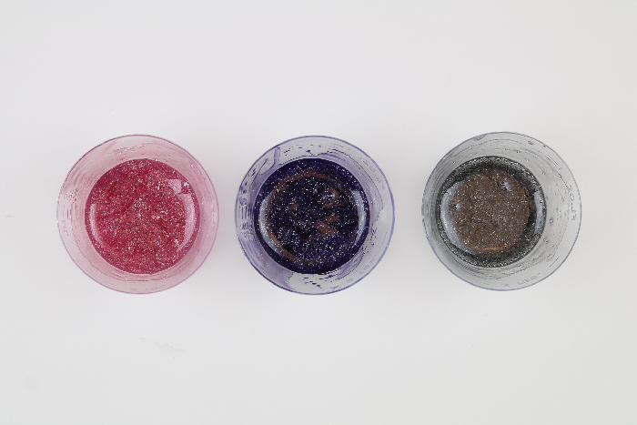 small containers of colorful resin