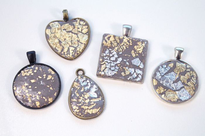 Repeat the process by adding jewelry clay with gold and silver leaf on the pendant bezels