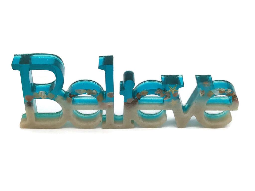 Believe resin sculpture