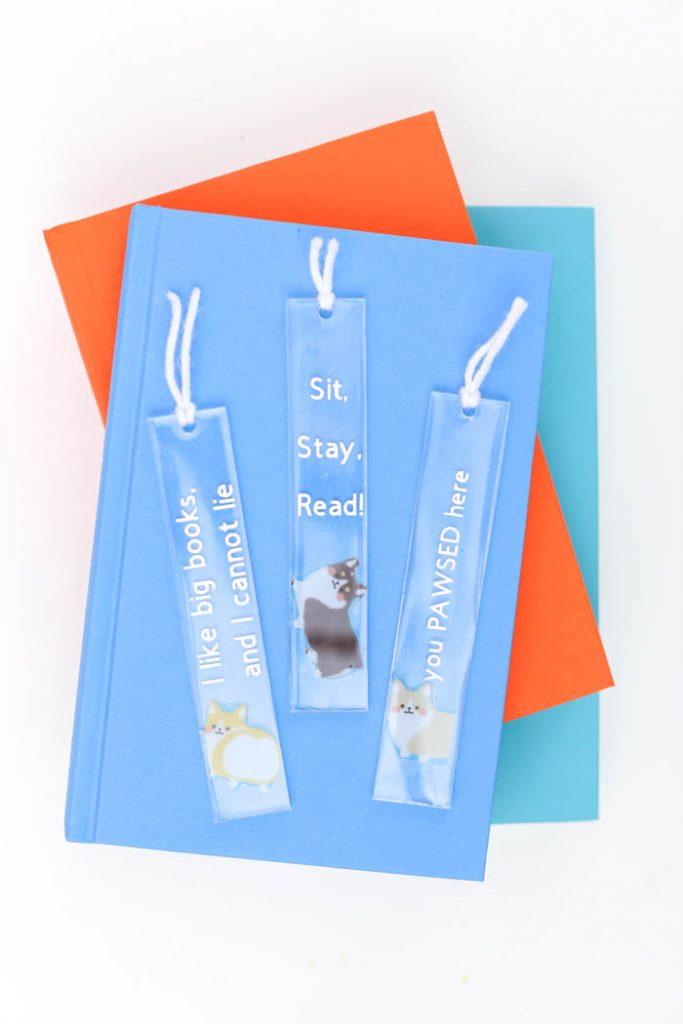 adorable corgi bookmarks on a stack of books