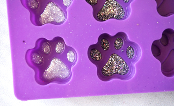 dog paw mold with white and silver resin