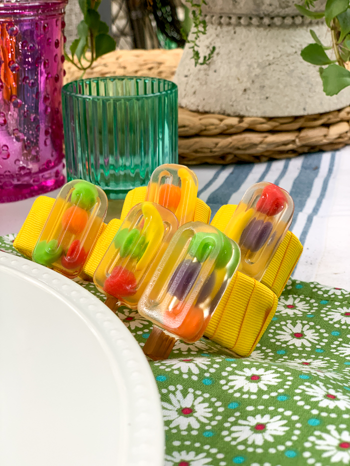 These adorable DIY resin napkin rings are made with EasyCast Clear Casting Epoxy. Popsicle napkin rings add a fun touch to your summer table.