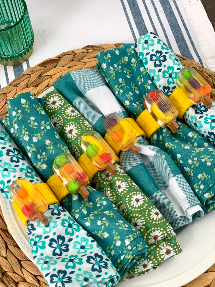 """These DIY """"fruit filled"""" popsicle napkin rings are so adorable for summer! See how she used Runts candies and resin to make these."""