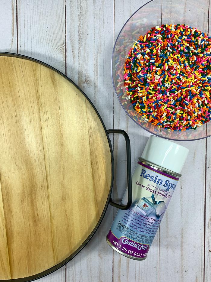 Use Castin'Craft Resin Spray to seal rainbow sprinkles before encasing them in resin.